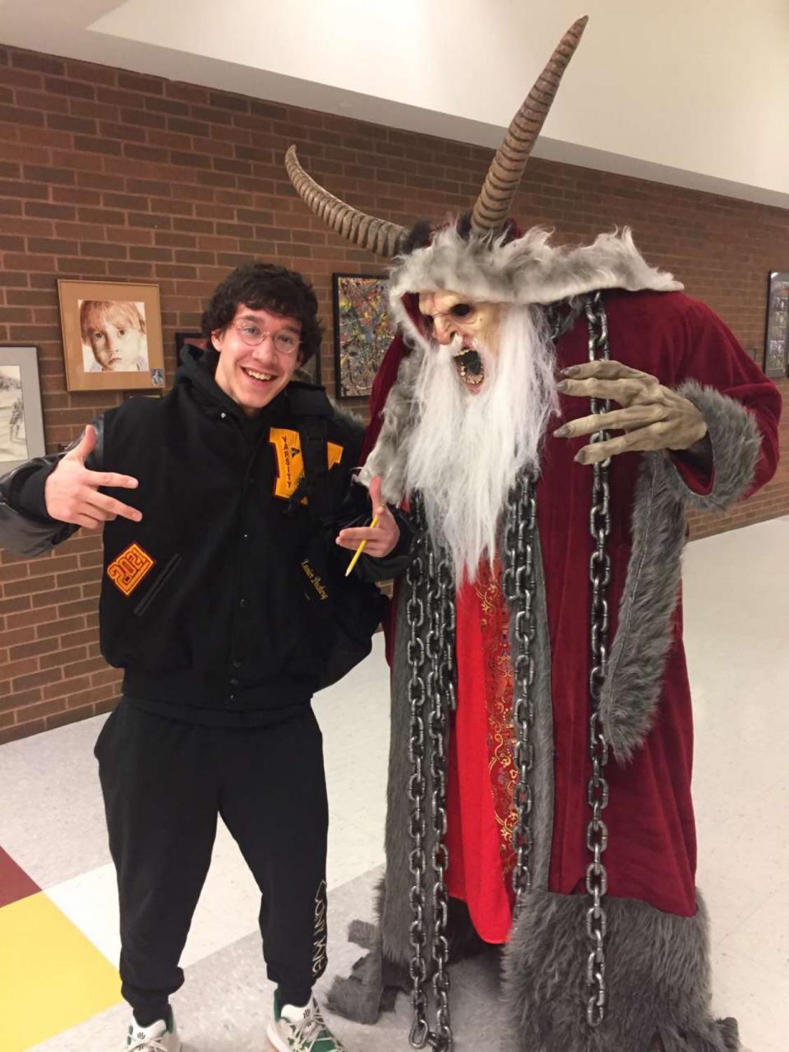 Xavier Dockery posing with Dr. Hartnell in his Krampus outfit.