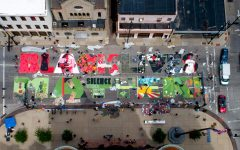"Local Cincinnati artists create a street mural that reads, ""Black Lives Matter"" on June 18, 2020, on Plum Street in front of City Hall in Cincinnati."