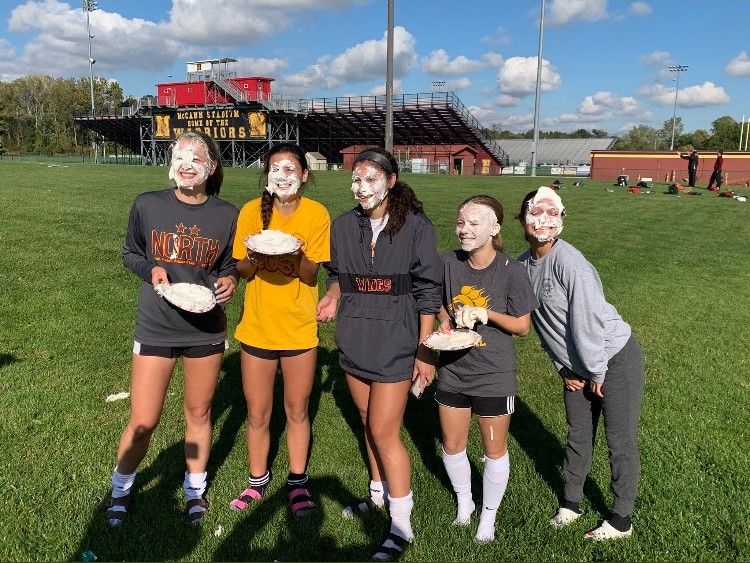 Five girls soccer seniors moments after getting pied in the face. Courtesy of Jolie Helt