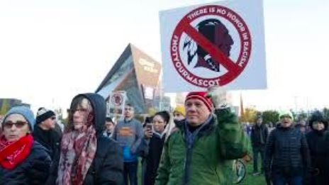 Protesters marching for name change from teams like the Indians and the Redskins. Picture courtesy of TampaBayTimes.com